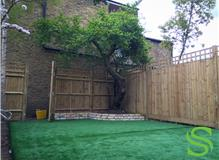 Curved brick Wall Flowerbed - Astro Turf in Chiswick