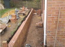 Kitchen exstention with retaining wall
