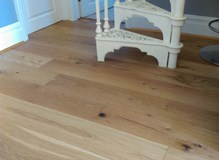 Engineered wood cut neatly around staircase (took me ages, but worth it !)