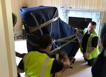 removal of a steinway  concert baby grand piano