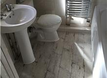 Basin and bath removed, floor tiled with shabby sheek tiles, new  taps on bath and basin, new heated
