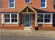 Renewal of bays, porch, lower pitch roof, brickwork and bespoke front door