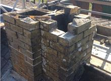 Rebuild on a listed train station chimney stack