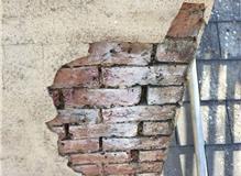 Damaged chimney stack