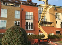 Gutter clearance using spider lift