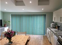 Vertical blinds with alternating slats