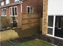 Fence panels fitted with new posts sunk in brickwork & wall rendered back in to match.