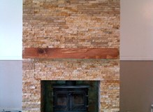 Fireplace clad with natural stone tiles with an Indian sandstone base.