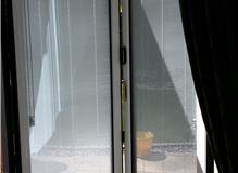 White inside Aluminium bi folds with uni-blinds