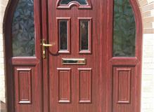 Rosewood arched upvc front door