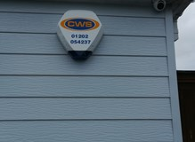 Siren fitted to cladded bungalow