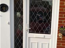 White uPVC door and sidelight