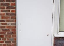 Old wooden escape door for a Dental Studio in Southampton