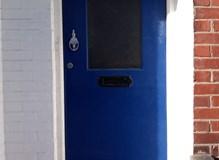 Old wooden front door in Southampton
