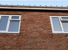Installation of new PVC windows with old tile cils removed & new row of bricks added in Fareham