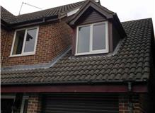 Replacement soffits, bargeboards, guttering and velux window
