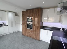 Gloss White Slab, Accented with Gloss Timber
