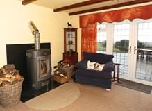 E730 Masonry Heater in a large farm house