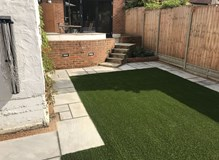 New Indian Sandstone patio and artificial lawn