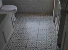 Bathroom floor layed and walls tiled