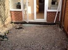 Put paving slabs down in back garden