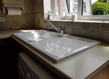 A beautiful crisp looking sink installed for a lovely little old lady, we installed a lever mixer ta