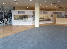 Karndean straight lay to a bar area with carpet laid to dinning area.
