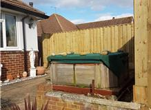 TIMBERWALL FENCING AROUND A HOT TUB
