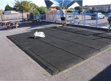 Take up existing rubber matting and form a fenced in soft play area for the little ones.