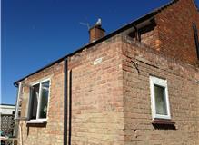 Complete removal of old roof,fix new structure and form a warm insulated roof