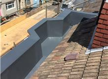 GRP gulley and parapet walls.