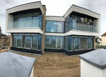 Curtain walling with sliding doors