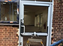 Aluminium commercial door with pvc side light