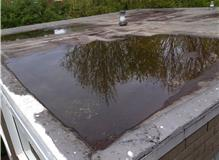 Existing roof with large pooling