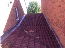 old tiled roof with leaking valley