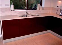 High Gloss Burgundy kitchen with Granite worktops