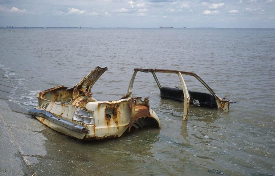 rusty car in the sea