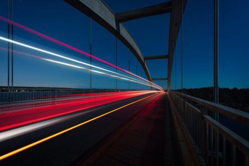 Car light trails on a bridge