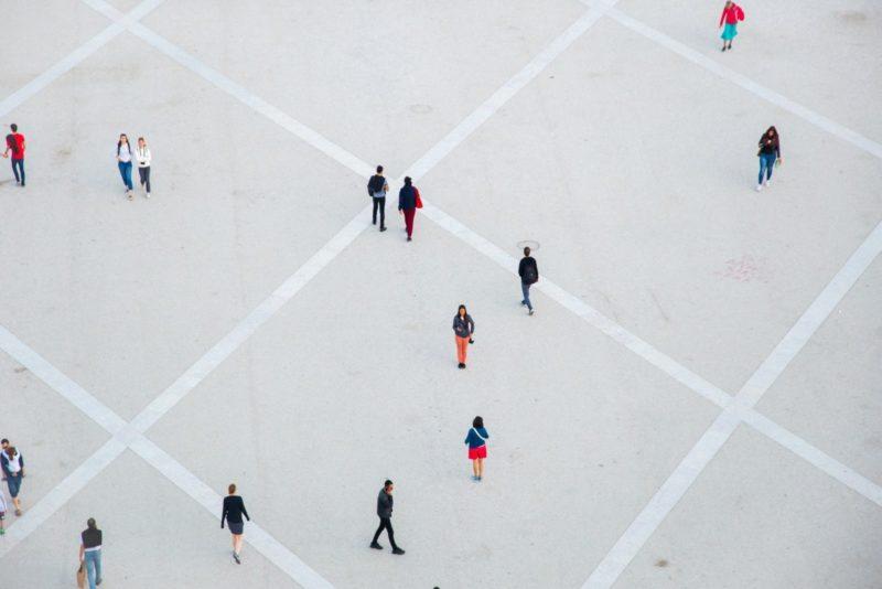 Aerial view of people walking - Photo by Ryutaro Tsukata