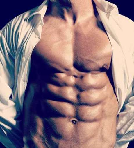 Man with chiseled abs standing with his shirt open. Explore our naught