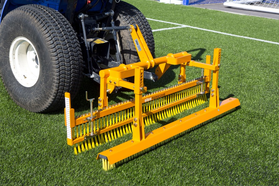 Tractor mounted brush system