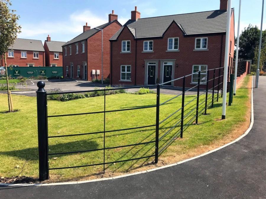 Estate Railing Creates Boundary for Housing Development