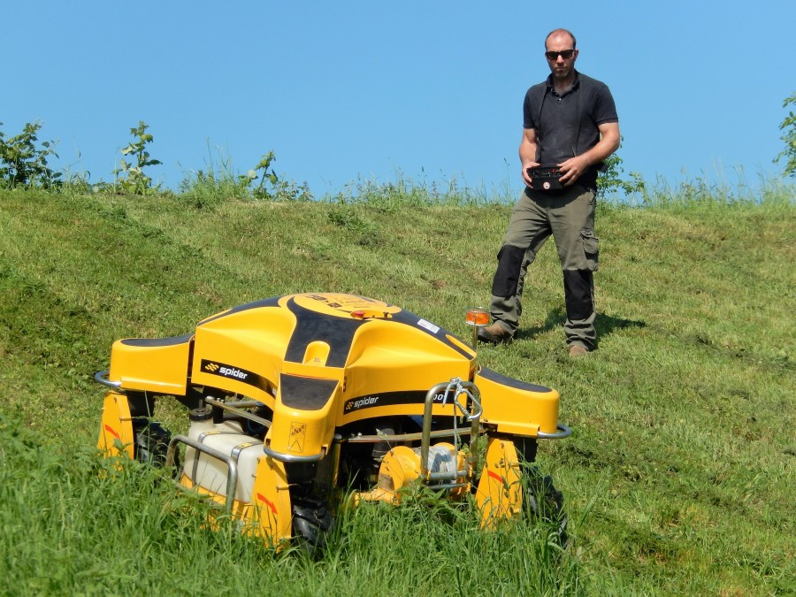Spider mower maintains slopes