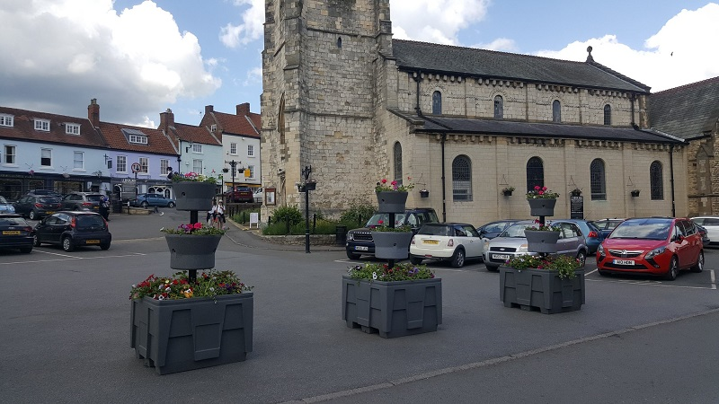 Town finds floral way to manage traffic