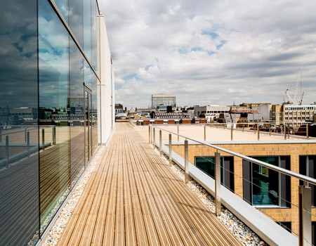 Treated softwood decking meets architectural aesthetics at mixed use development