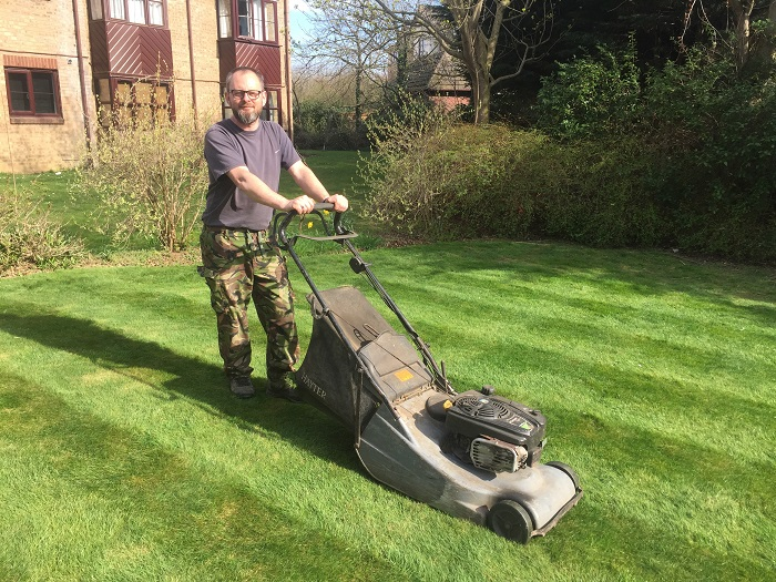 Man walks length of the world with Hayter mower