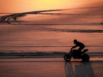 motorbike stunt rider arunas gibieza drifting his street bike on snow