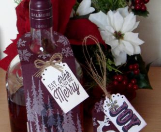 A bottle gift tag with a male theme