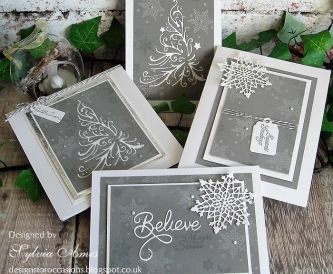 Christmas Greetings In Grey And White with Snowflakes