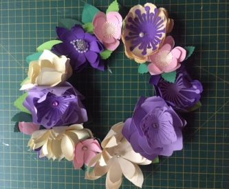 Creating a simple spring wreath out of recycled paper flowers.